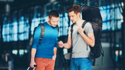 Two young men at the airport