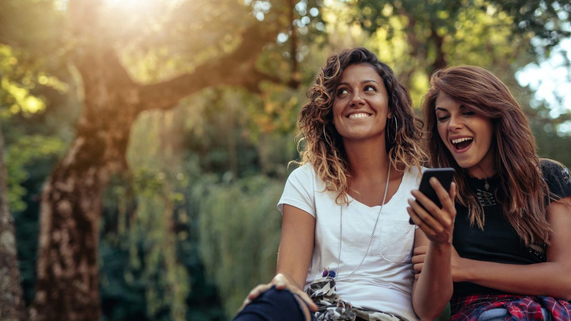 two-young-women-on-phone