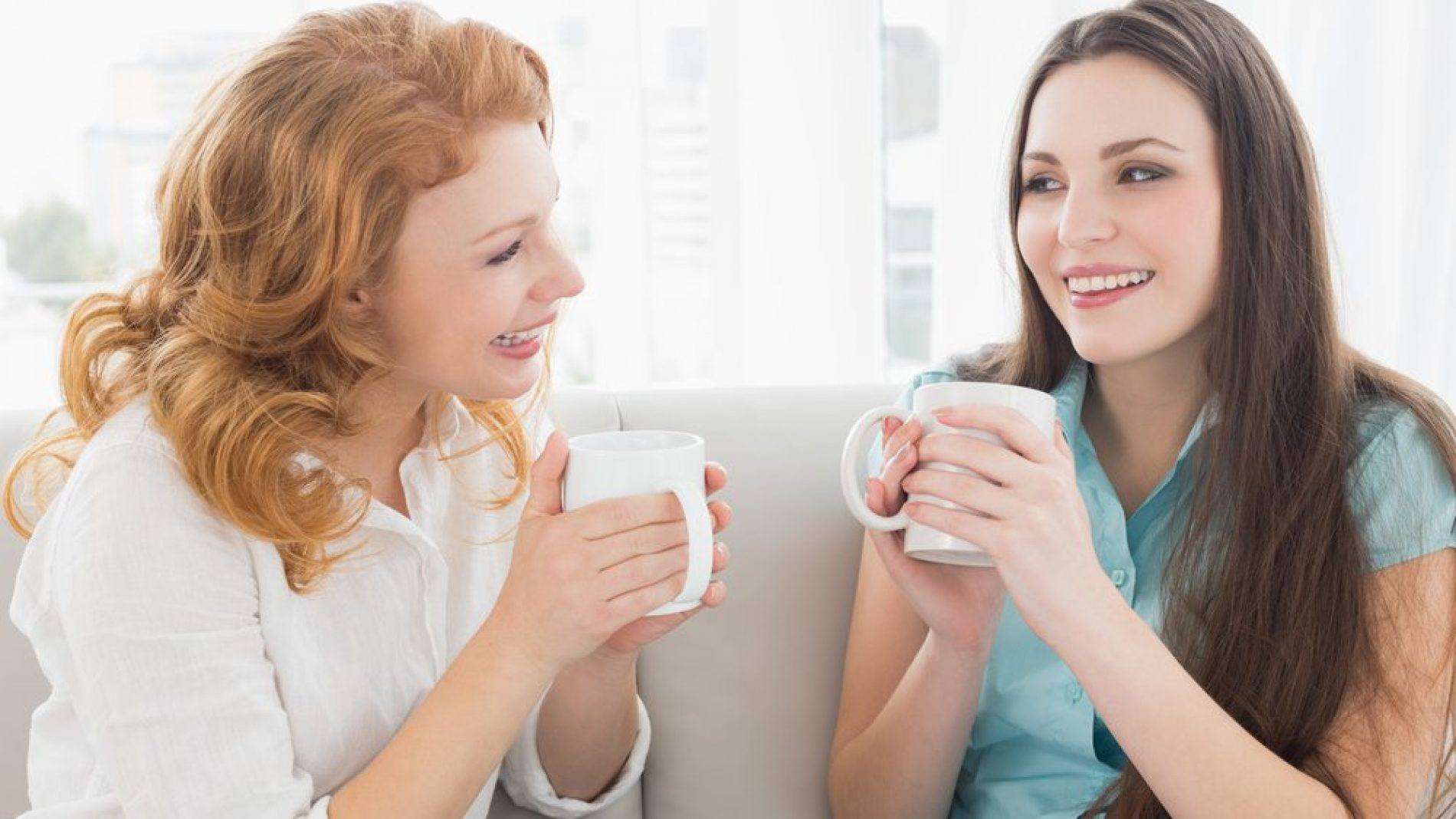 two_women_talking_with_cup_of_tea