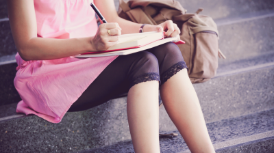 Picture of a girl writing in a notebook