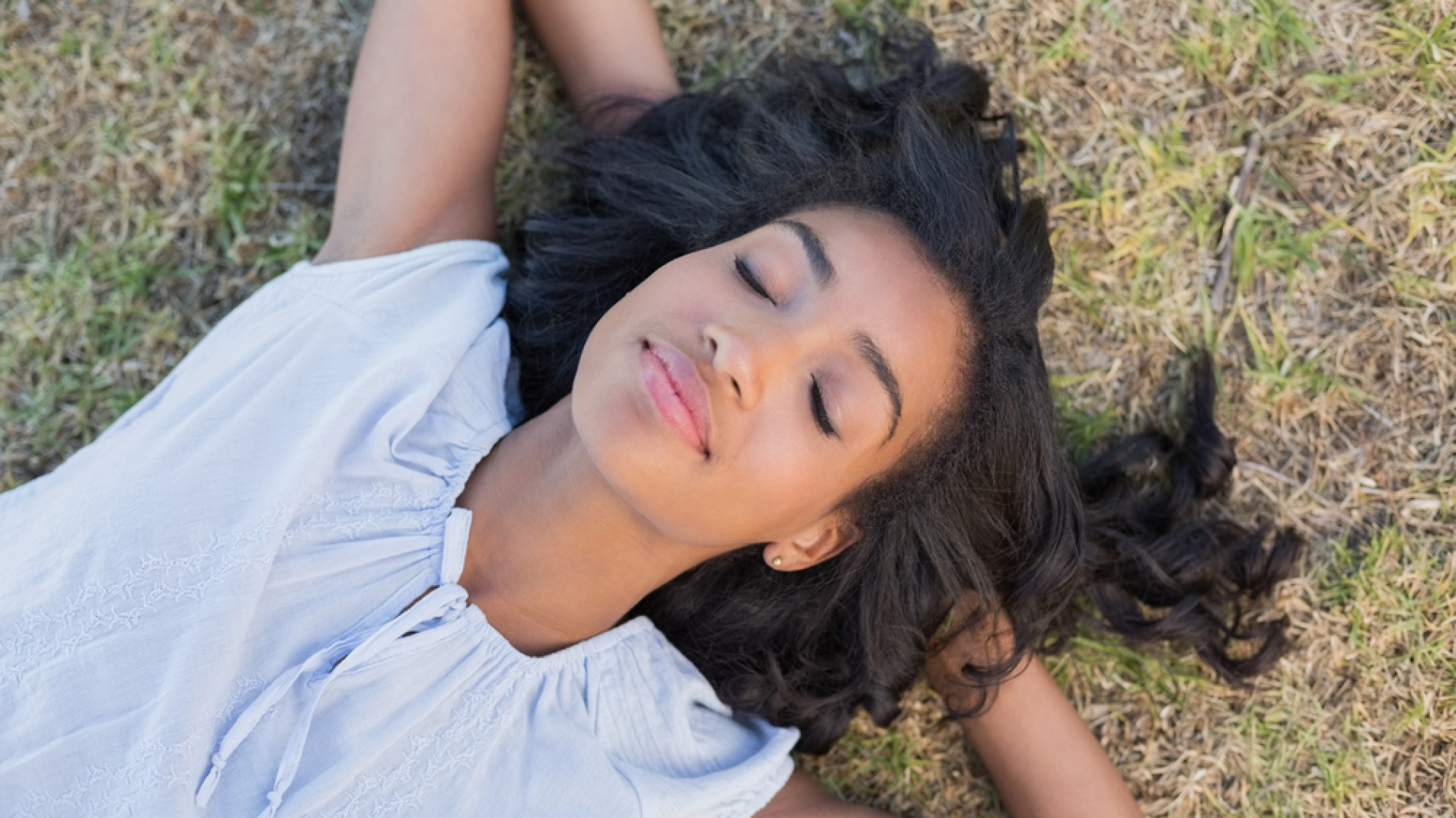 A young woman sleeping on the ground
