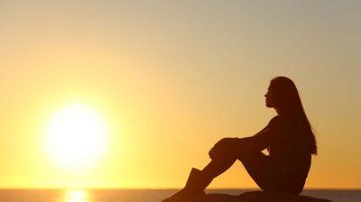 woman watching a sunset