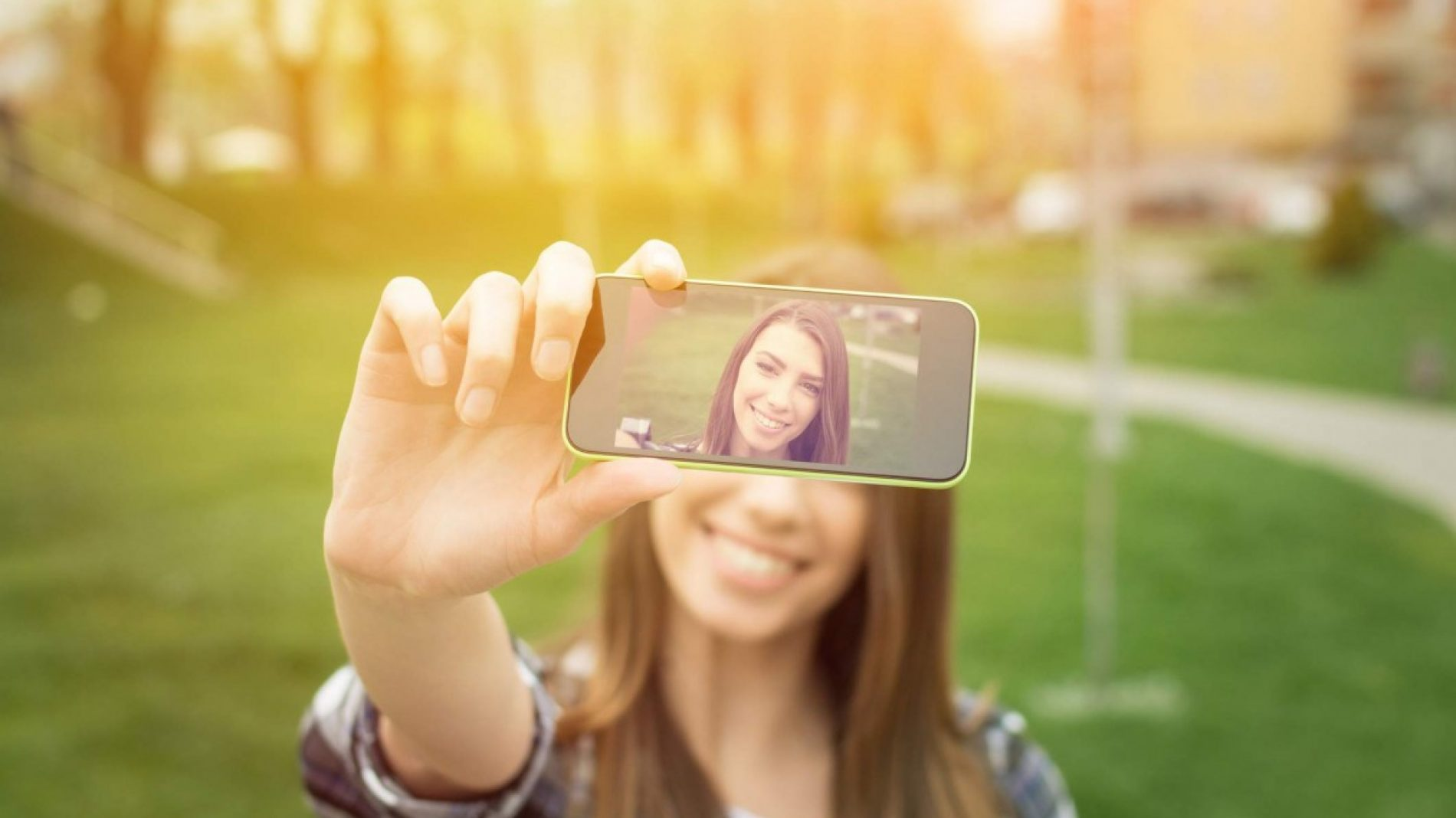 woman taking a selfie in the park