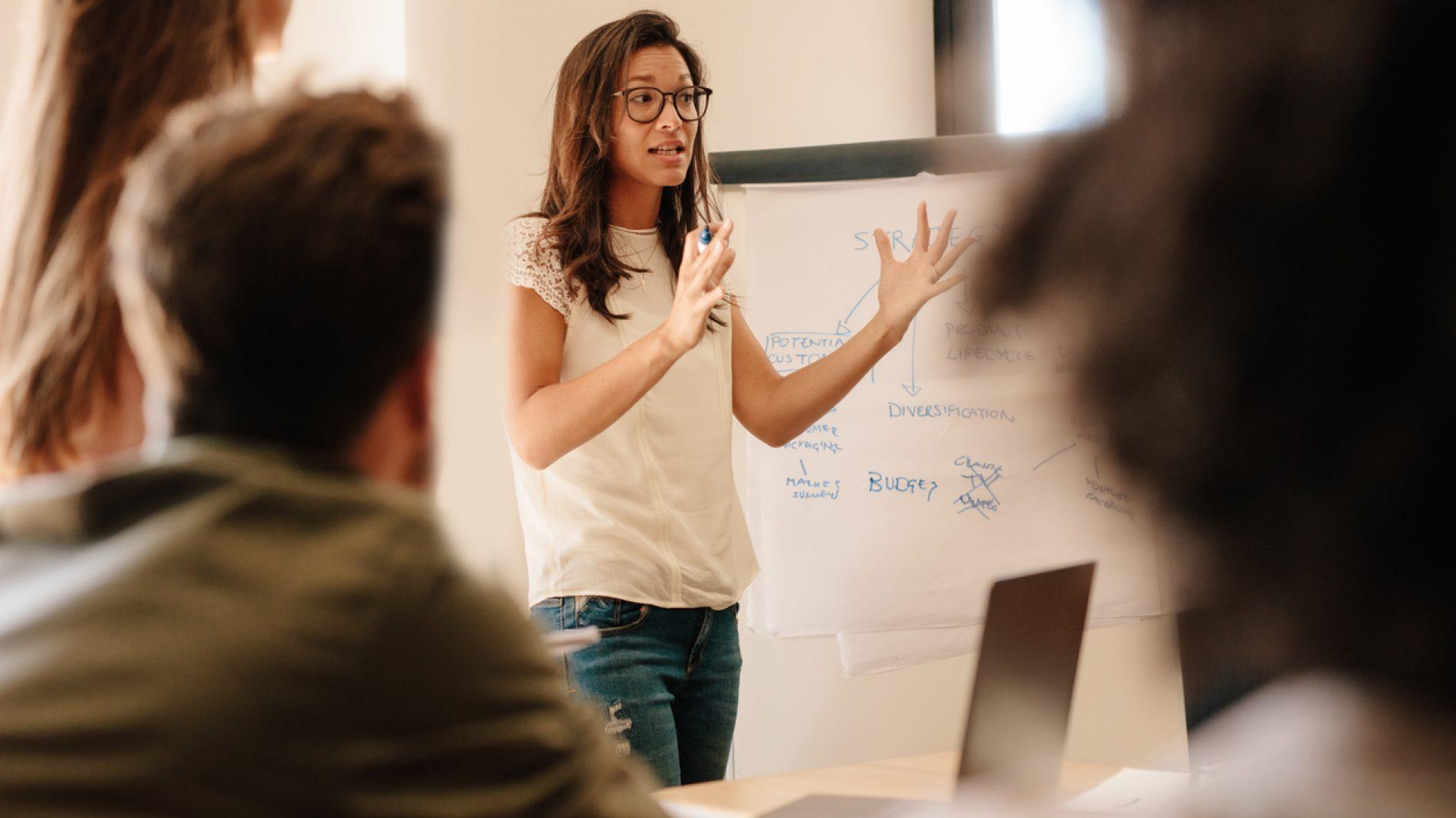 Woman talking at a workshop