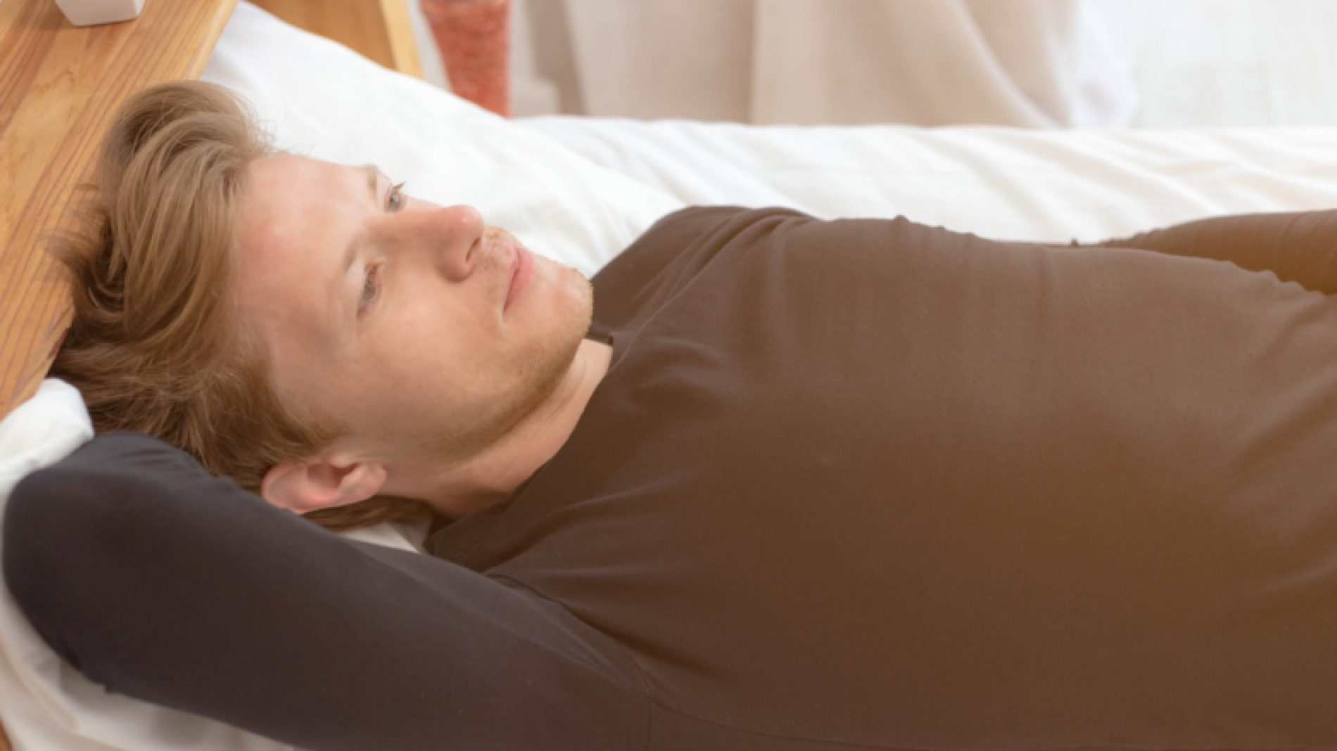 young-man-feeling-down-in-bed-cQjln7