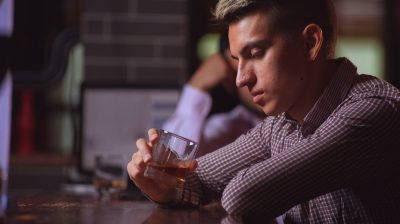 young-man-looking-at-drink