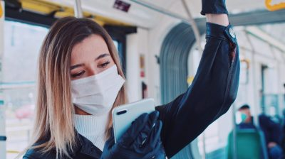 young-person-wearing-a-mask-on-the-bus