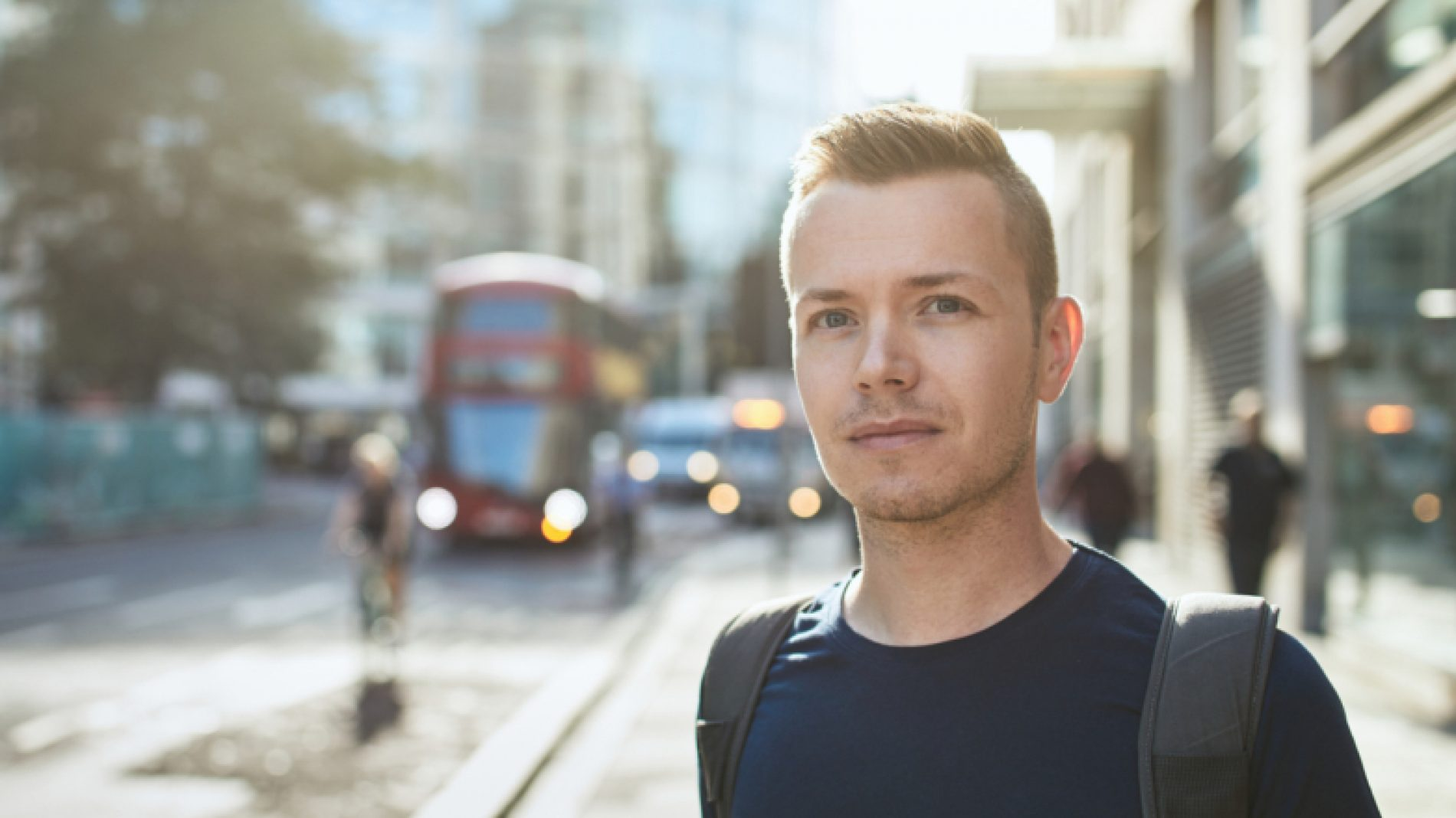 young-person-with-bus-in-the-background-2cu25x
