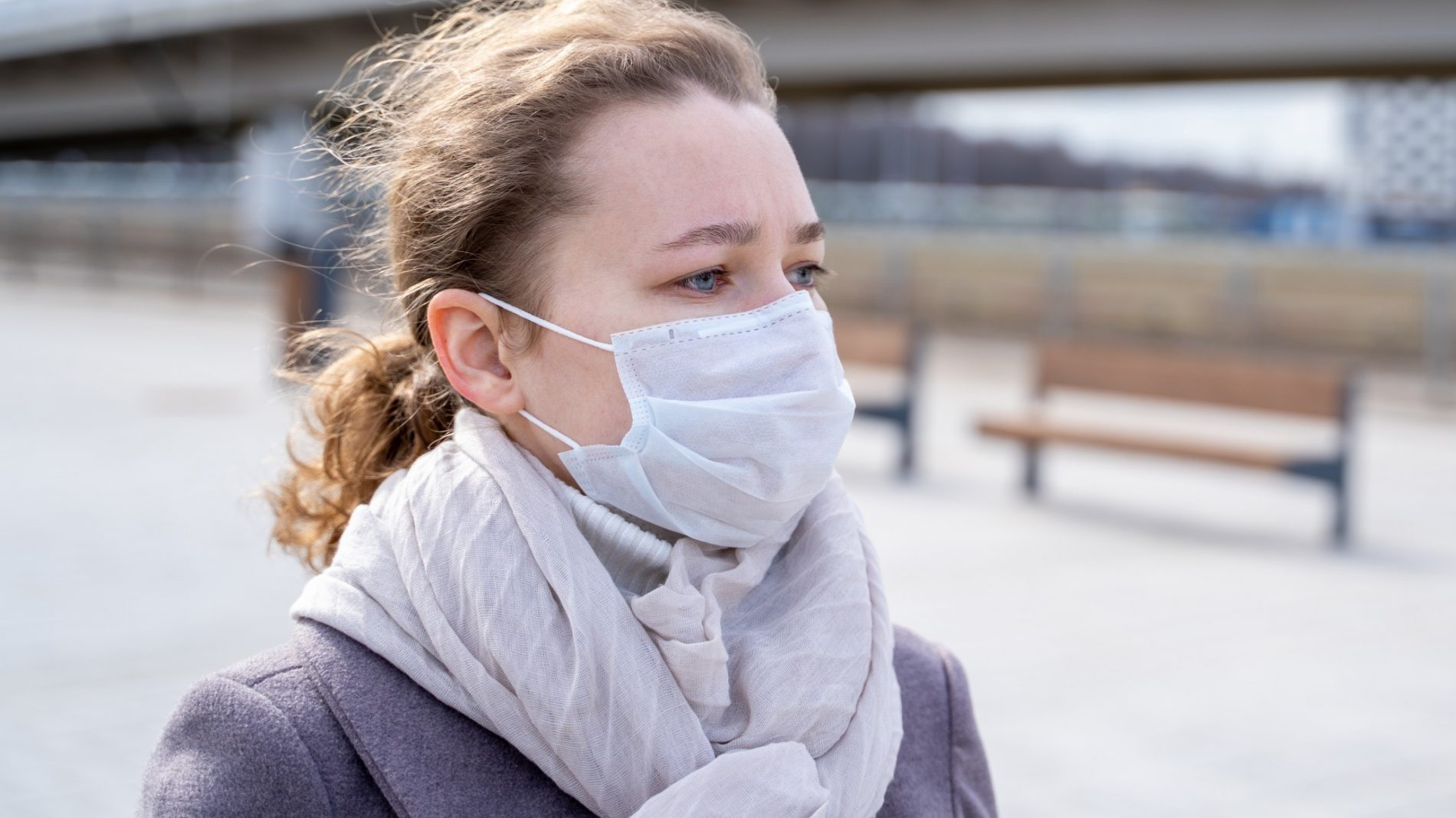 Young person outside with a facemask on