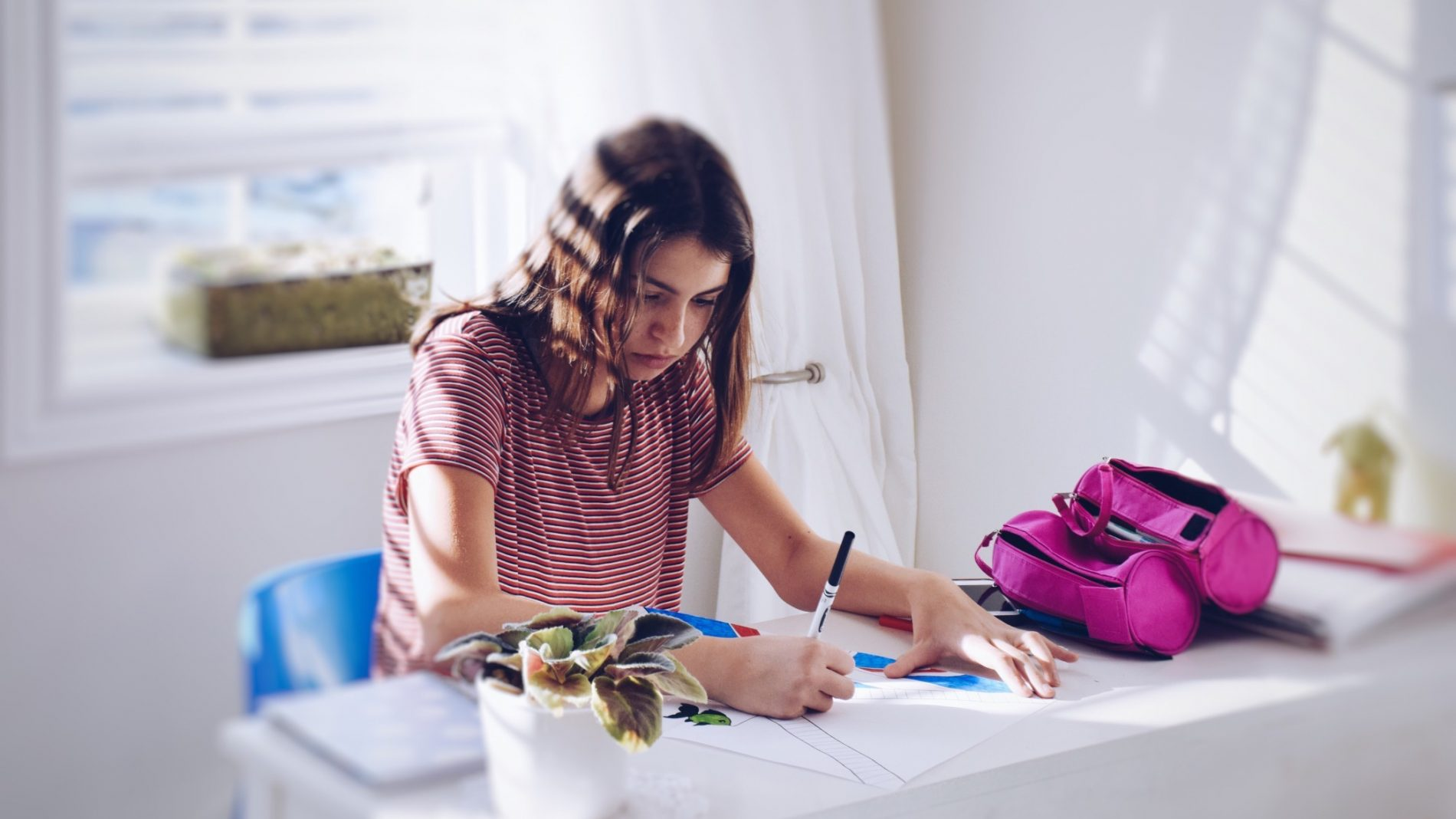 young-teenage-girl-working-on-her-school-project-in-a-brightly-lit-room_t20_7mXnpy