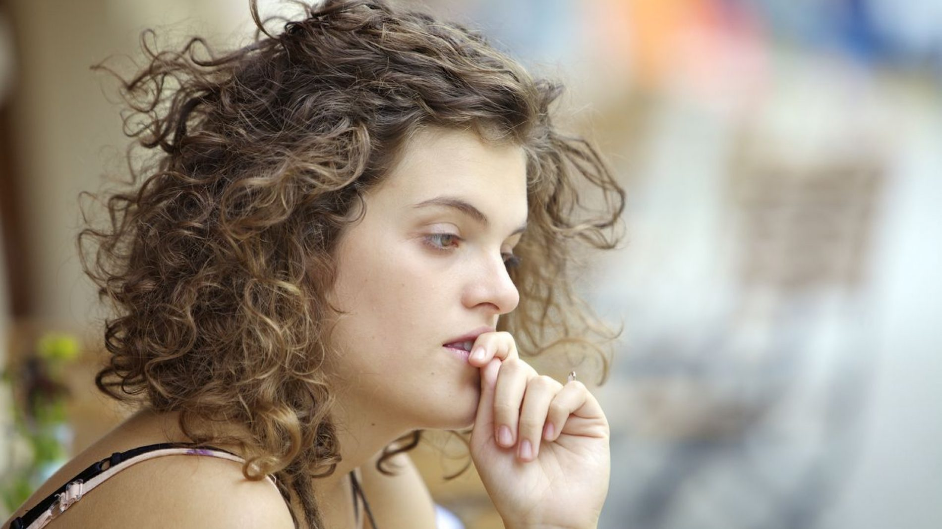 Young woman thinking and looking worried