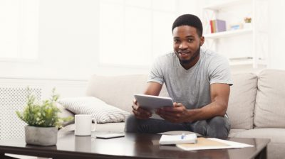 Young man on couch with tablet