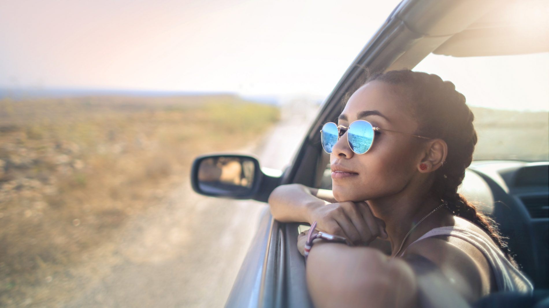 Trendy girl traveling by car