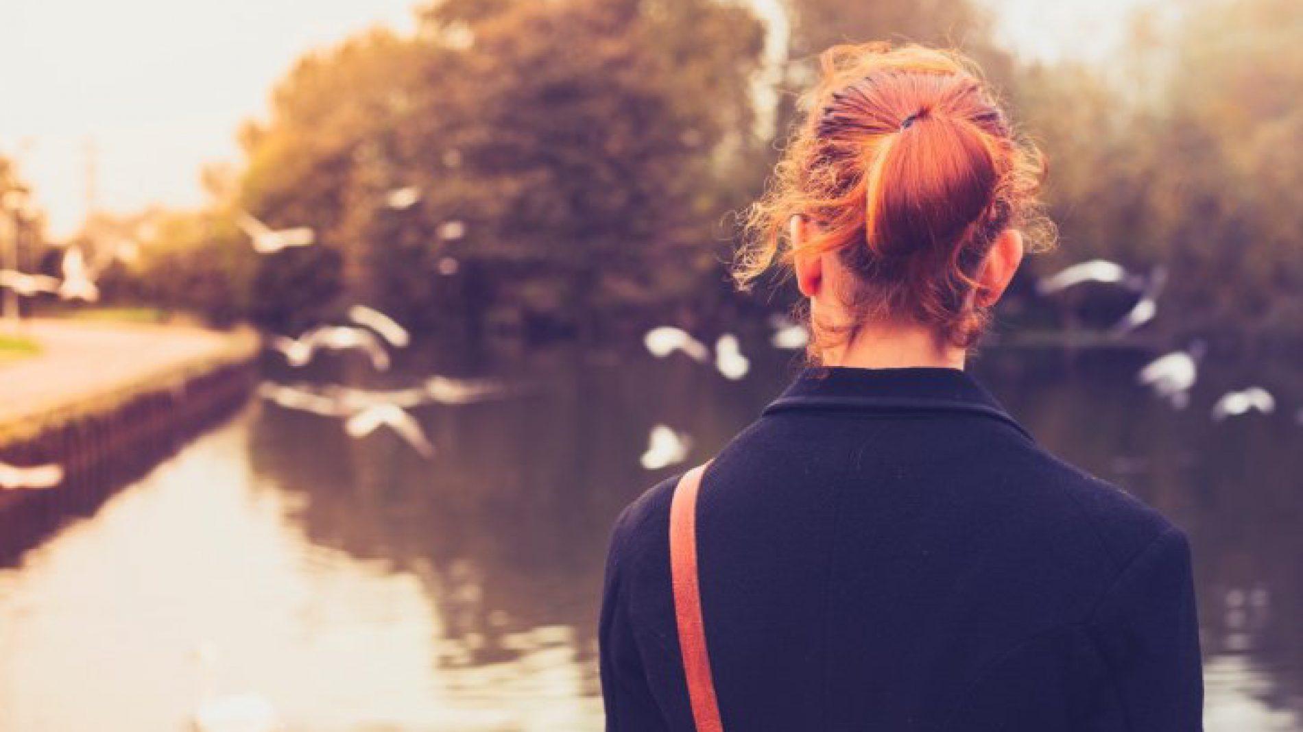 young_woman_overlooking_lake