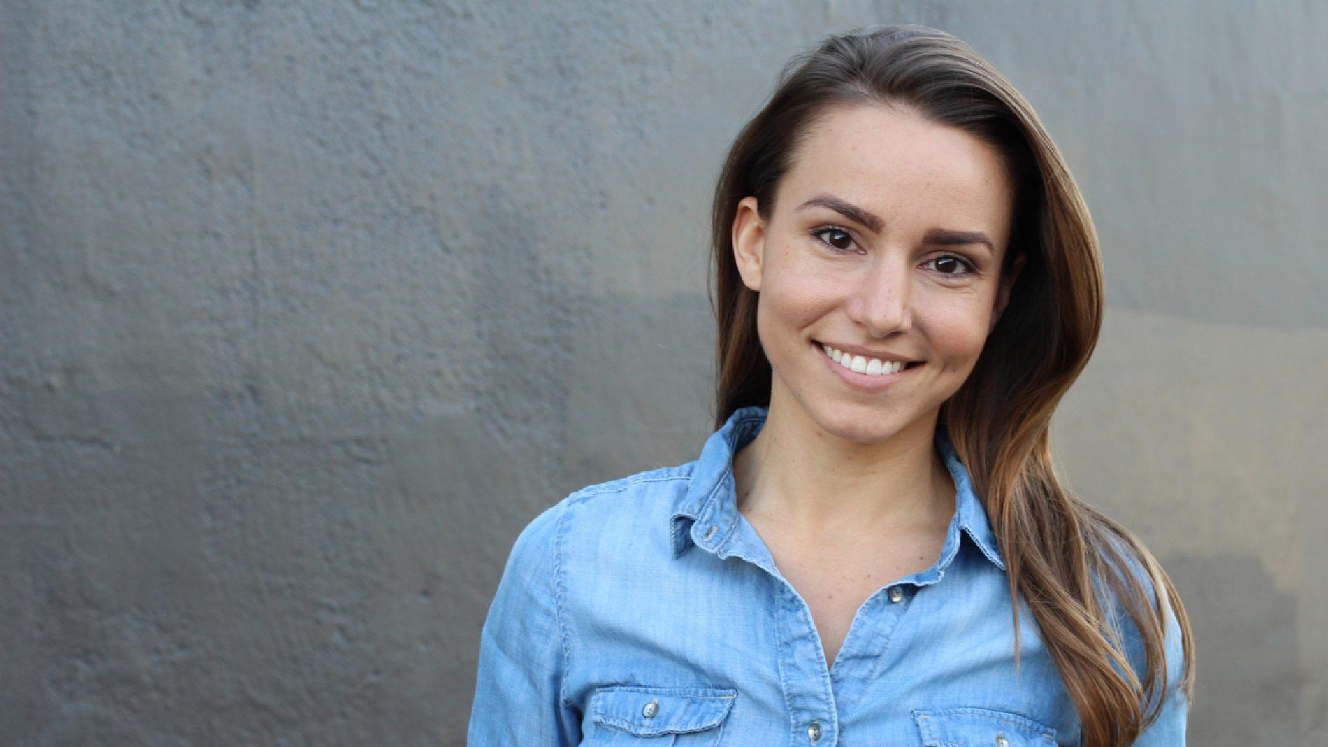 Beautiful woman in denim shirt smiling